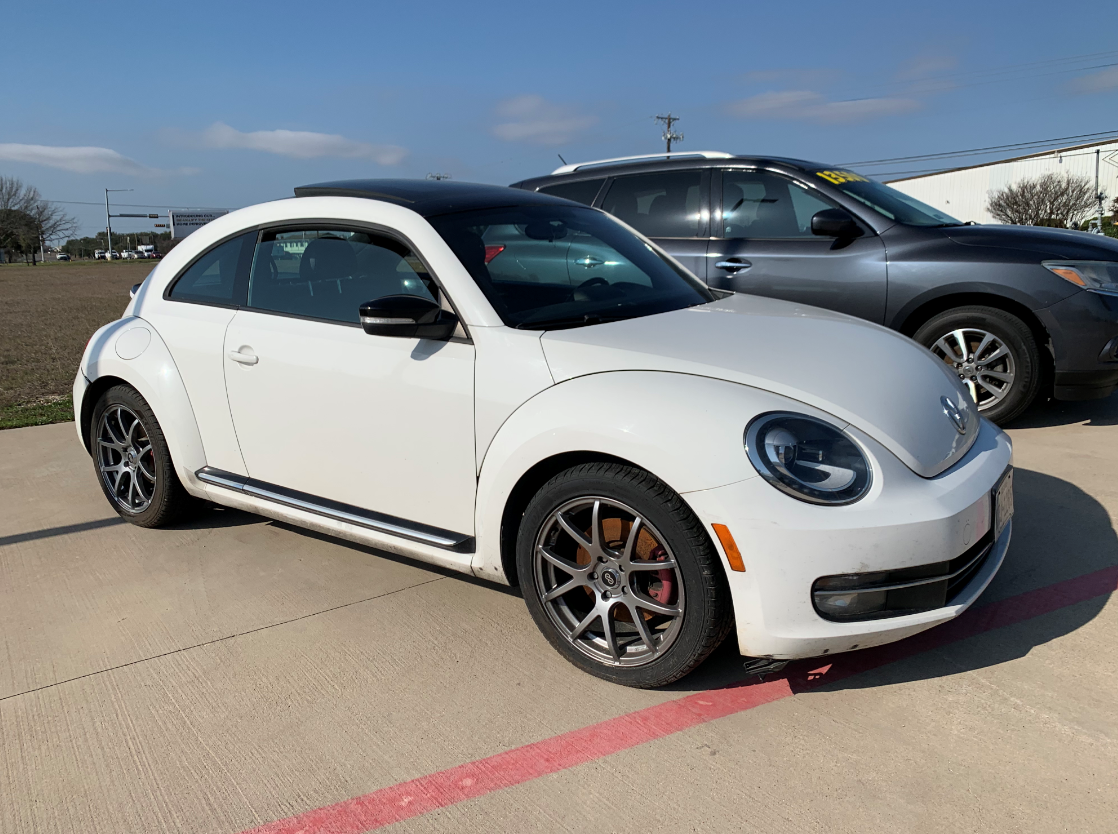 2012 white volks wagon beetle 2 door